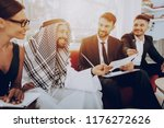 arabian businessman discussion... | Shutterstock . vector #1176272626
