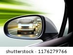 reflection of traffic flow in... | Shutterstock . vector #1176279766