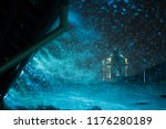 heavy snowfall in a night city. ...   Shutterstock . vector #1176280189
