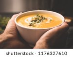 bowl of warm pumpkin soup in... | Shutterstock . vector #1176327610
