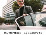 happy mature commuter getting... | Shutterstock . vector #1176359953
