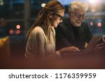 two business professionals... | Shutterstock . vector #1176359959