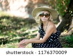 woman in a hat. in long polka... | Shutterstock . vector #1176370009