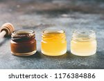 honey in small jars and wooden... | Shutterstock . vector #1176384886