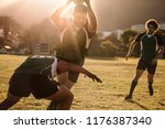 rugby players running with ball ...   Shutterstock . vector #1176387340