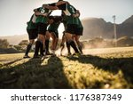 Rugby players in a huddle...