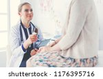 doctor and patient discussing... | Shutterstock . vector #1176395716