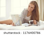 relaxed young woman sitting on... | Shutterstock . vector #1176400786