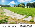 green grass field with park... | Shutterstock . vector #1176400909