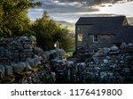 a stone cottage at dusk in the... | Shutterstock . vector #1176419800