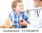 doctor and child patient.... | Shutterstock . vector #1176426070