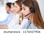 call center. beautiful cheerful ... | Shutterstock . vector #1176427906