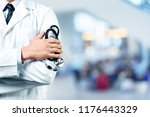 young man doctor holding... | Shutterstock . vector #1176443329