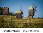 three windmills on picturesque... | Shutterstock . vector #1176453049