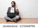 young man sitting on the floor... | Shutterstock . vector #1176468706