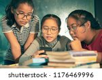 group of asian teenager reading ... | Shutterstock . vector #1176469996