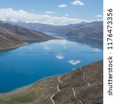 lake snow mountain road | Shutterstock . vector #1176473356
