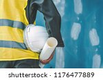 the male architect holding a... | Shutterstock . vector #1176477889