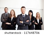 Stock photo group of business people with businessman leader on foreground 117648706