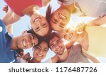 group of happy young people in... | Shutterstock . vector #1176487726