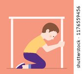 boy hiding under table because... | Shutterstock .eps vector #1176559456