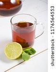 hot black tea served with lime... | Shutterstock . vector #1176564553