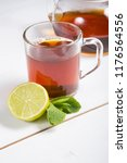 hot black tea served with lime... | Shutterstock . vector #1176564556
