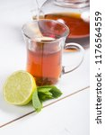 hot black tea served with lime... | Shutterstock . vector #1176564559