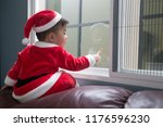baby in santa dresses and... | Shutterstock . vector #1176596230