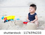 first year old boy play with... | Shutterstock . vector #1176596233