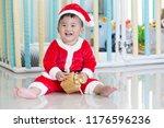 baby in santa dresses on... | Shutterstock . vector #1176596236