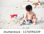 first year old boy play with... | Shutterstock . vector #1176596239