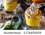 pumpkin mousse with whipped... | Shutterstock . vector #1176603439