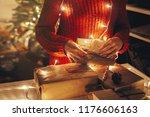 christmas magic moments. hands... | Shutterstock . vector #1176606163