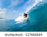 surfer riding large blue ocean... | Shutterstock . vector #117660664