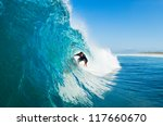 Surfer On Blue Ocean Wave In...