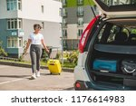 woman pull suitcase on wheels... | Shutterstock . vector #1176614983