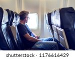 passenger traveler looking at... | Shutterstock . vector #1176616429