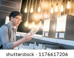 young asian man choosing... | Shutterstock . vector #1176617206