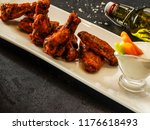 buffalo chicken wings bbq with...   Shutterstock . vector #1176618493