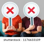 people holding incorrect tick... | Shutterstock . vector #1176633109