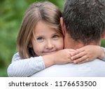 portrait of cute little girl... | Shutterstock . vector #1176653500