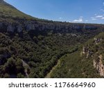 a canyon with a long river ... | Shutterstock . vector #1176664960