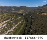 a canyon with a long river ... | Shutterstock . vector #1176664990