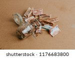 cash money dropping from a... | Shutterstock . vector #1176683800