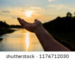 male hand pointing at sun in...   Shutterstock . vector #1176712030
