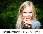 child blong girl posing in... | Shutterstock . vector #1176723490