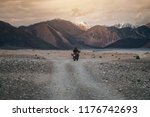 tourist riding an adventure... | Shutterstock . vector #1176742693