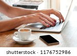 young woman working with laptop ... | Shutterstock . vector #1176752986
