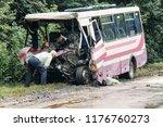 man looks at the broken bus... | Shutterstock . vector #1176760273